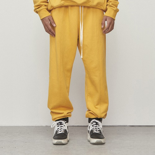 [D.PRIQUE] Logo Jogger Pants Yellow